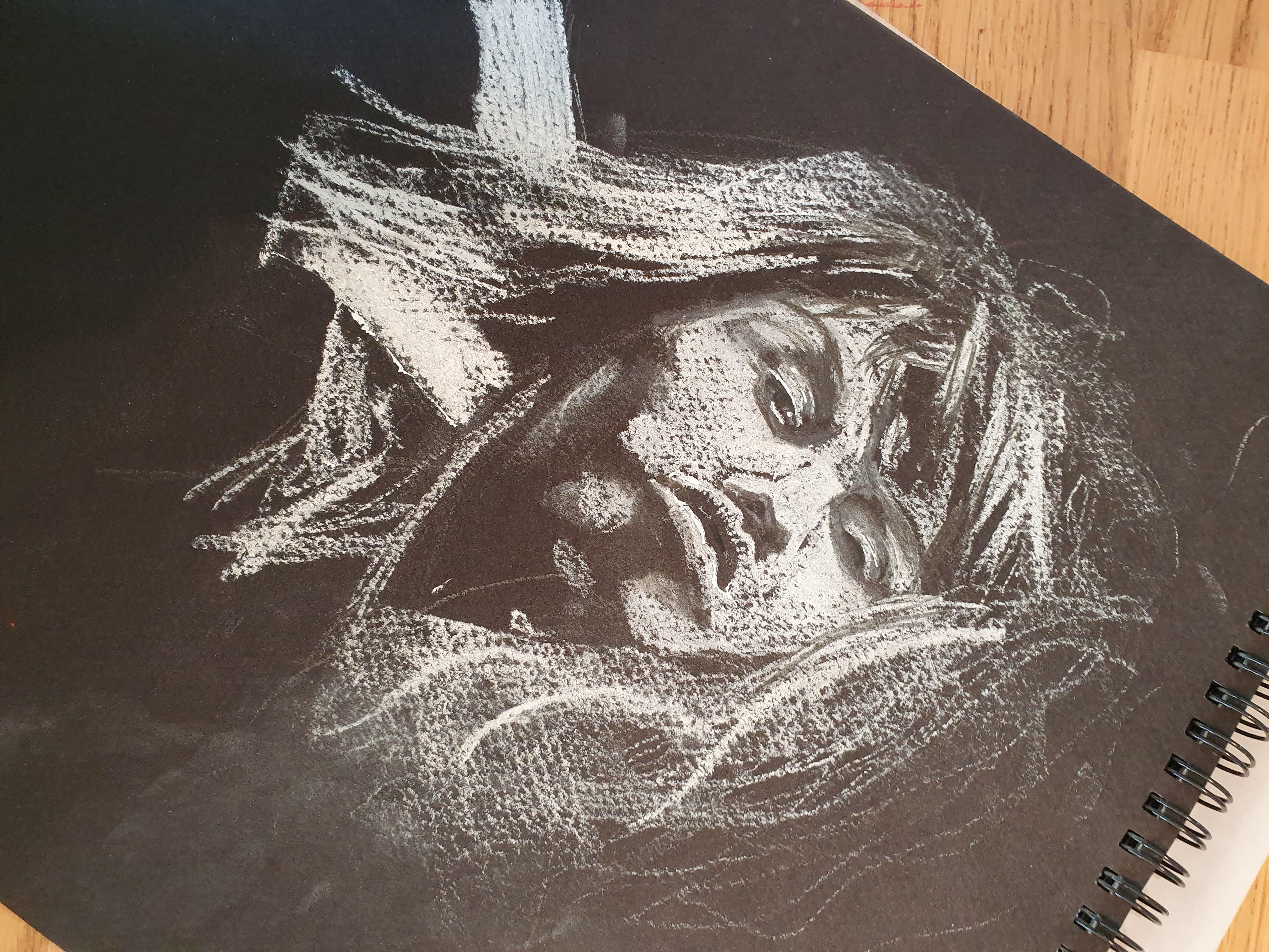 Portrait craie blanche sur papier noir  cours de dessin