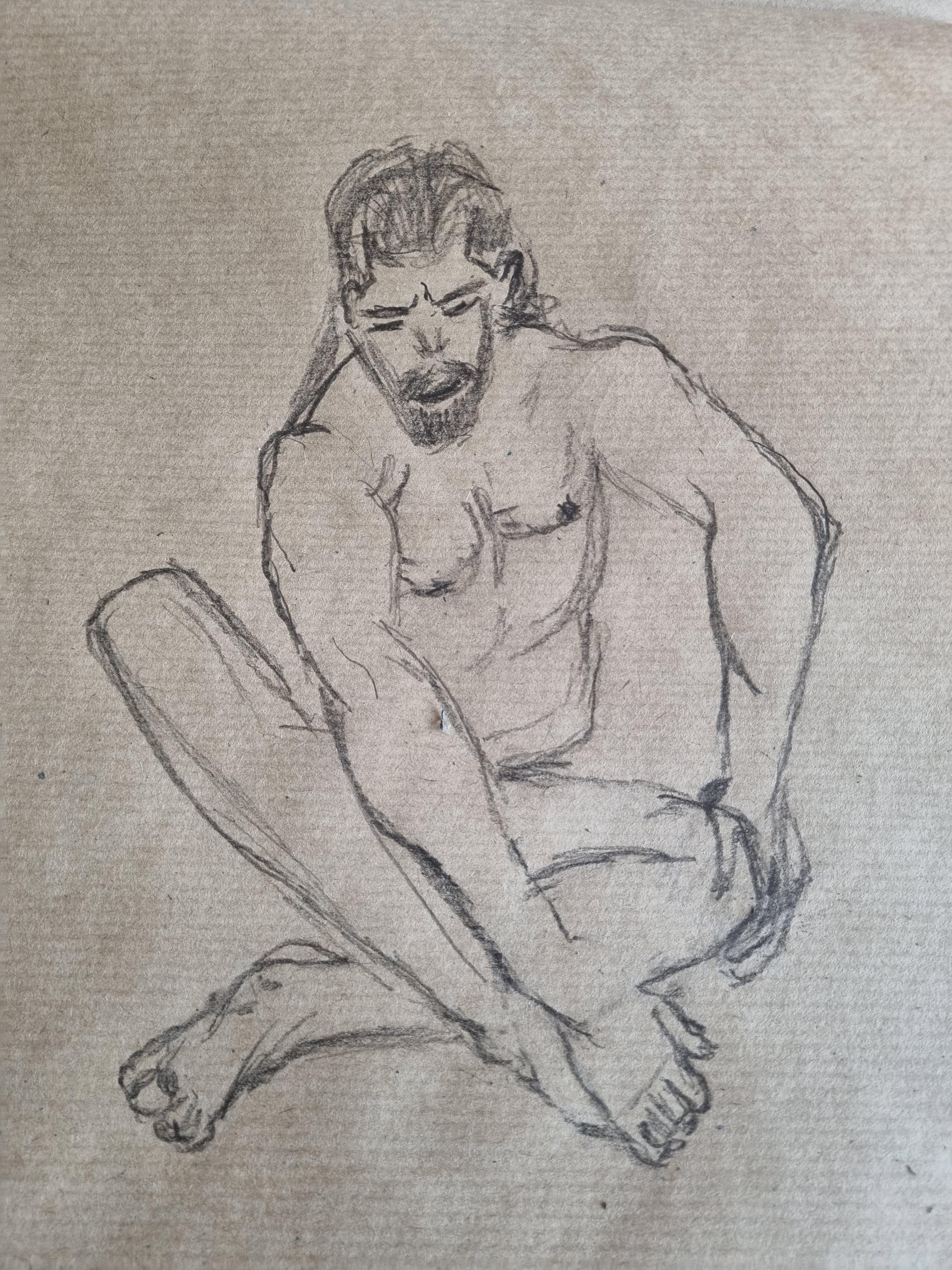 Dessin graphite homme assis sur papier Kraft  cours de dessin